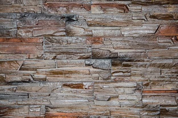 Texture du mur de béton gris moderne fait de blocs