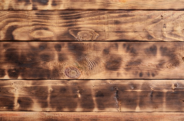 La texture du mur en bois brûlé