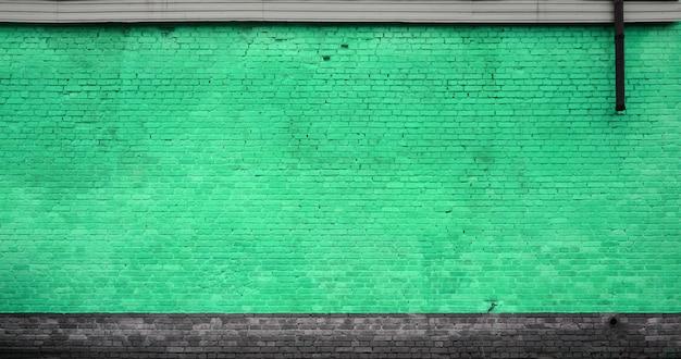 La texture du mur de briques de nombreuses rangées de briques peintes en vert