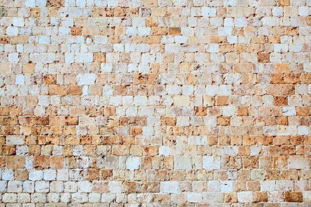 Texture du mur en pierre antique, fond d'architecture