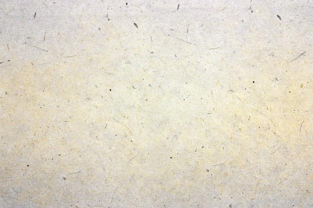 Texture du papier à la main pour le fond.