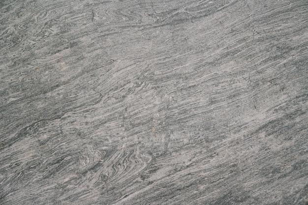La texture du sol en pierre noire peut être utilisée comme arrière-plan