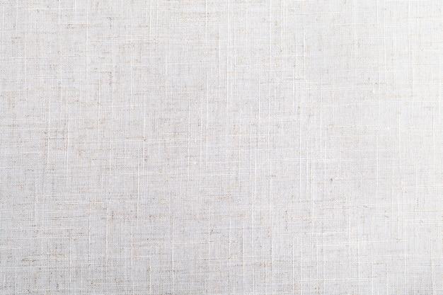La texture du tissu beige clair en fibre de lin naturelle