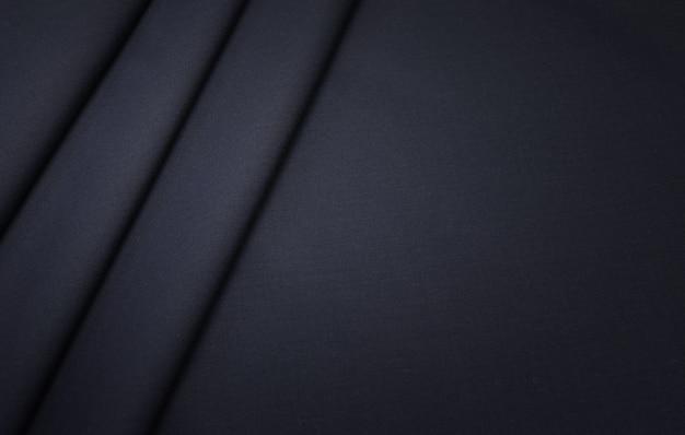 La texture du tissu en coton avec de la laine gris foncé.