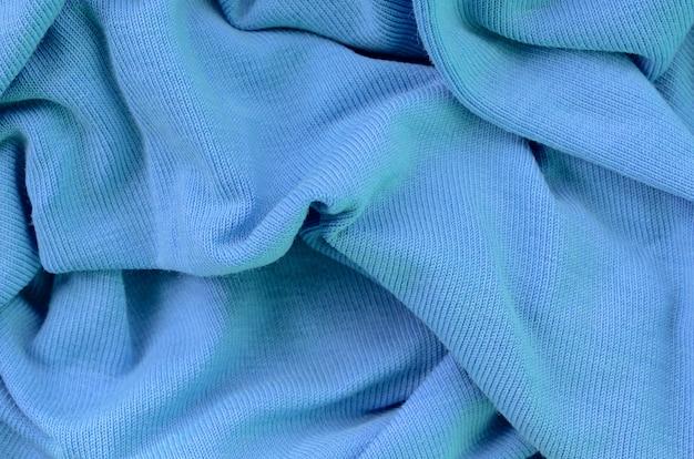 La texture du tissu en couleur bleue. matériel pour la confection de chemises et de blouses