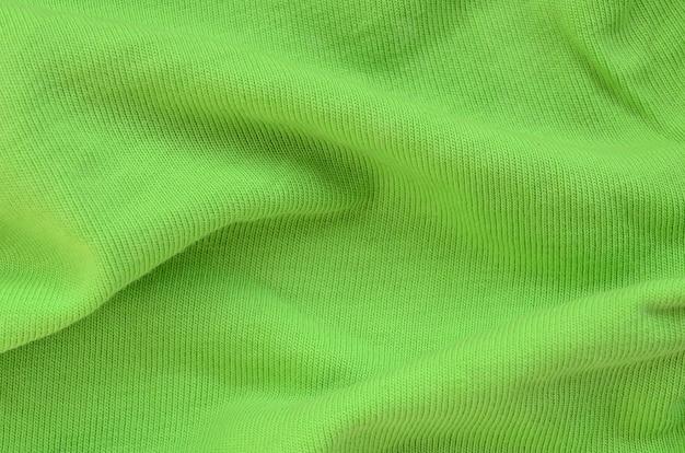 La texture du tissu est vert vif