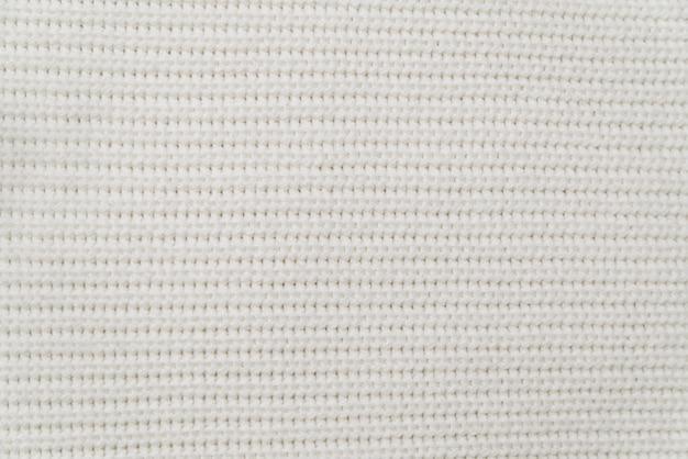 Texture du tissu d'un pull blanc chaud