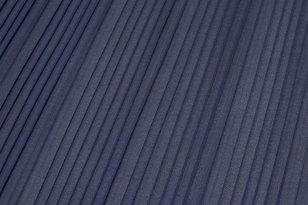 La texture du tissu synthétique est grise. plisse.