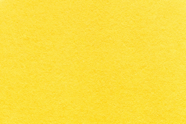 Texture du vieux fond de papier jaune clair, agrandi.