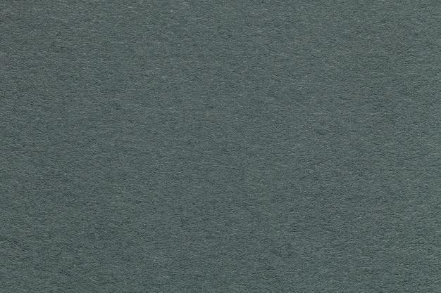 Texture du vieux fond de papier vert, gros plan. structure en carton gris dense