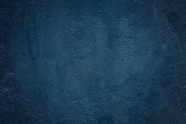 Texture du vieux mur de béton bleu foncé pour le fond