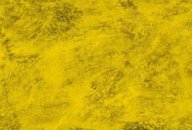 Texture du vieux mur de béton jaune.