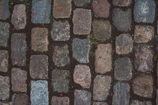 La texture du vieux pavé et des pierres inhabituelles