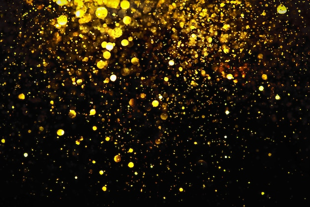 Texture d'éclairage bokeh paillettes dorées abstrait flou pour anniversaire, anniversaire, mariage, réveillon ou noël