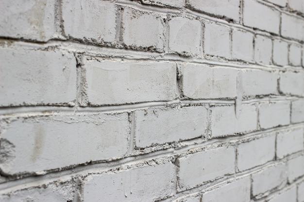 La texture est un mur de briques blanches à un angle