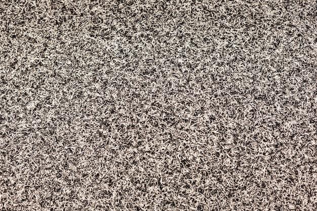 La texture est un tapis gris doux