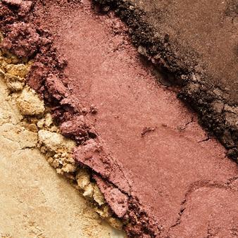 Texture de fard à paupières cassé ou poudre. le concept de l'industrie de la mode et de la beauté. fermer.