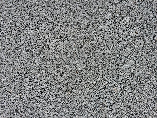 Texture de fils de plastique entrelacés utilisés dans les tapis