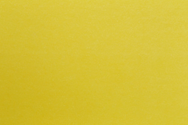 Texture de fond d'art en carton de papier jaune.