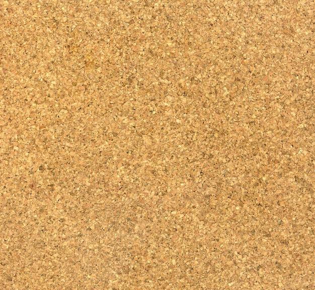 Texture de fond blanc de panneau de liège brun