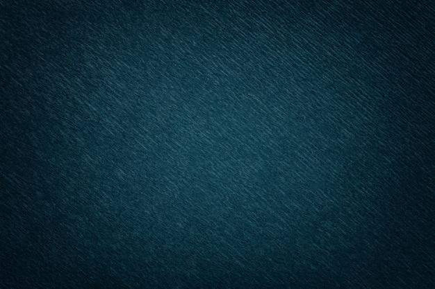 Texture de fond bleu marine de papier ondulé ondulé, agrandi.
