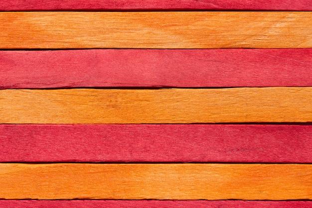 Texture fond de bois de couleur rouge et orange