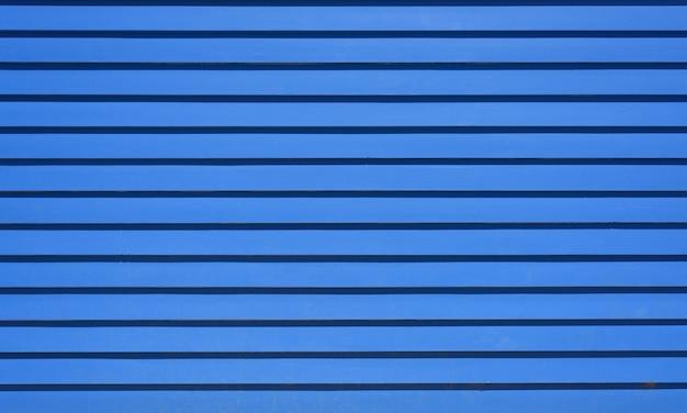 Texture de fond en bois à rayures horizontales bleues