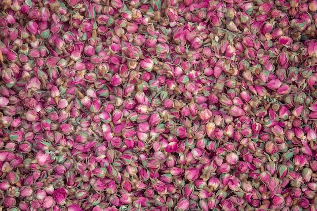 Texture de fond de boutons de rose séchées.