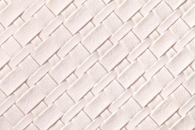 Texture de fond en cuir rose clair avec motif en osier, macro.