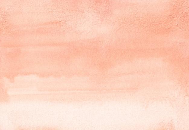 Texture de fond dégradé aquarelle corail clair. coups de pinceau sur papier. toile de fond couleur pêche. peinte à la main