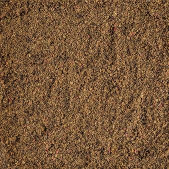 Texture de fond d'épices de poivre séché, vue de dessus