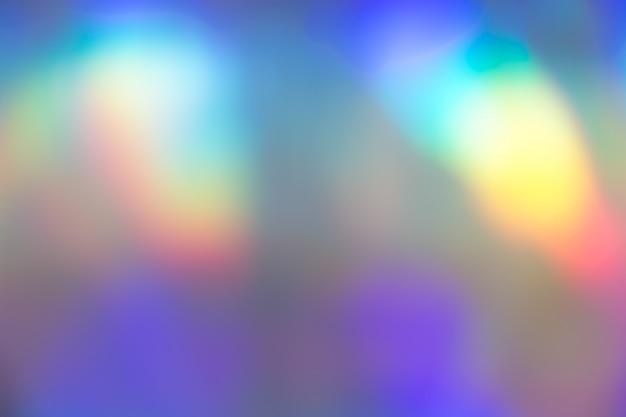 Texture de fond de feuille pastel holographique vibrante colorée. rave toxique, décor de fête.