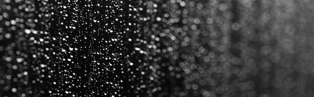 Texture de fond de goutte de pluie sur la surface du verre