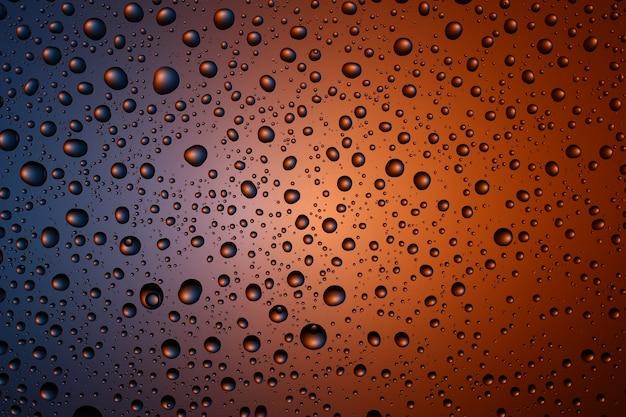 Texture et fond de gouttes d'eau sur un fond coloré