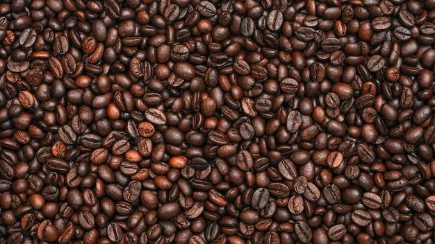 Texture de fond de grains de café torréfiés avec espace de copie