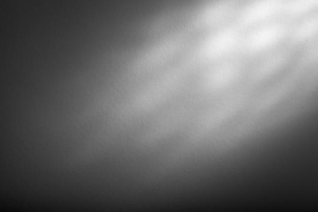 Texture de fond gris, rétro-éclairage supérieur.