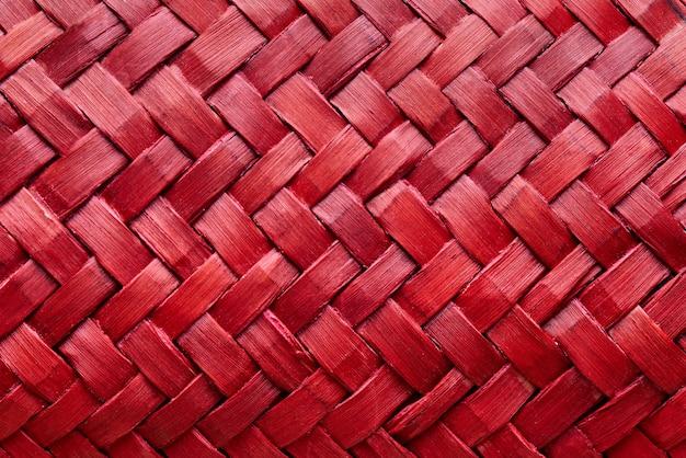 Texture de fond de gros plan de tissage rouge.