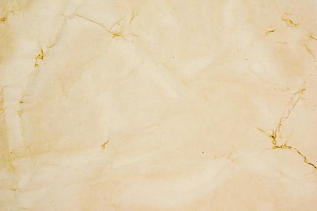 Texture de fond grunge papier beige rugueux pour la conception