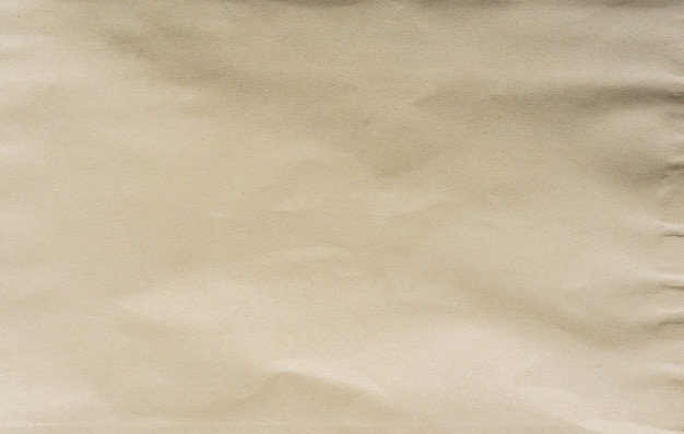 Texture de fond horizontale de papier de couleur marron et beige froissé