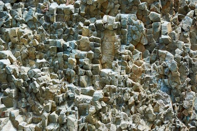 Texture de fond de la lave volcanique pétrifiée sur la côte.