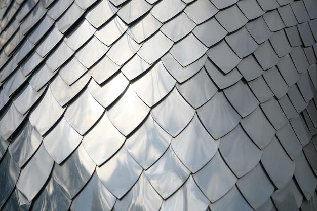 Texture de fond à la main artisanat d'échelle en métal argenté