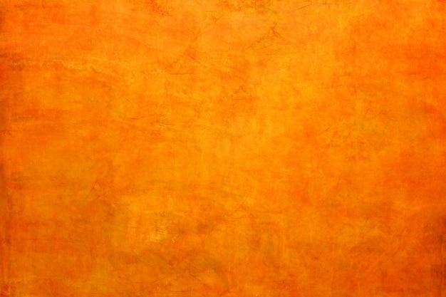 Texture de fond de mur en béton orange.