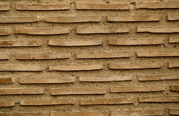 Texture de fond de mur de brique ancienne avec de longues briques minces entre la maçonnerie en rangées répétées