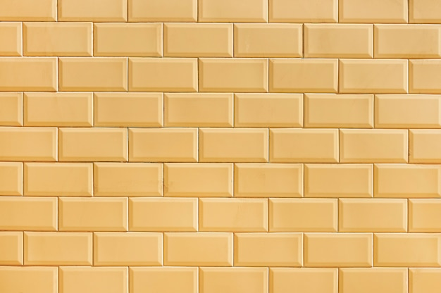 Texture de fond de mur de brique beige