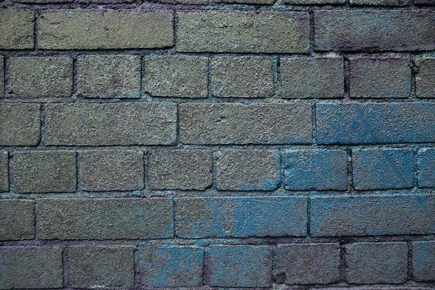 Texture de fond de mur de brique grunge gris et bleu. briques humides