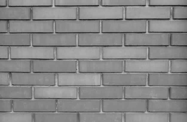 Texture de fond de mur de brique monochrome