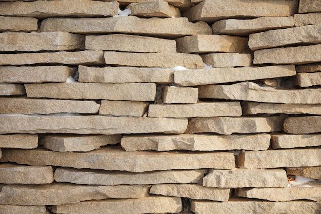 Texture de fond de mur de brique en pierre
