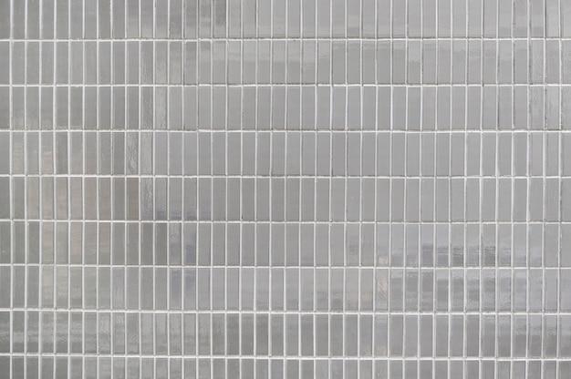 Texture de fond de mur de carreaux gris vieux