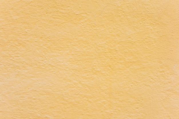 Texture de fond de mur jaune simple