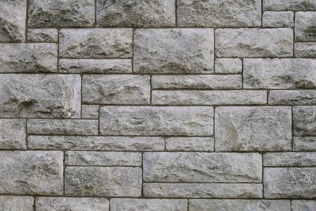Texture de fond de mur en pierre grise moderne